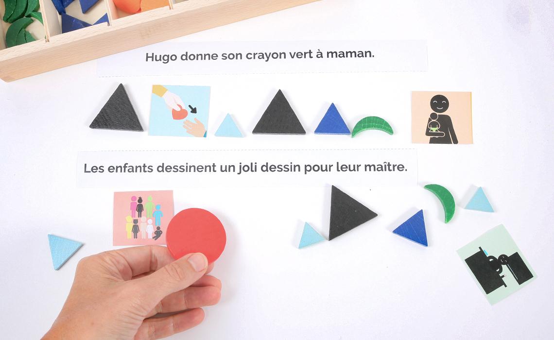 Un exercice de grammaire avec les symboles Montessori